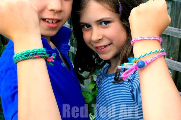 Young children with homemade friendship bracelets