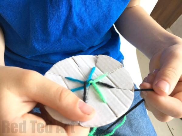 Boy making easy friendship bracelets